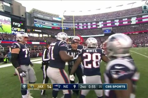 Referee celebrating in the endzone with Patriots